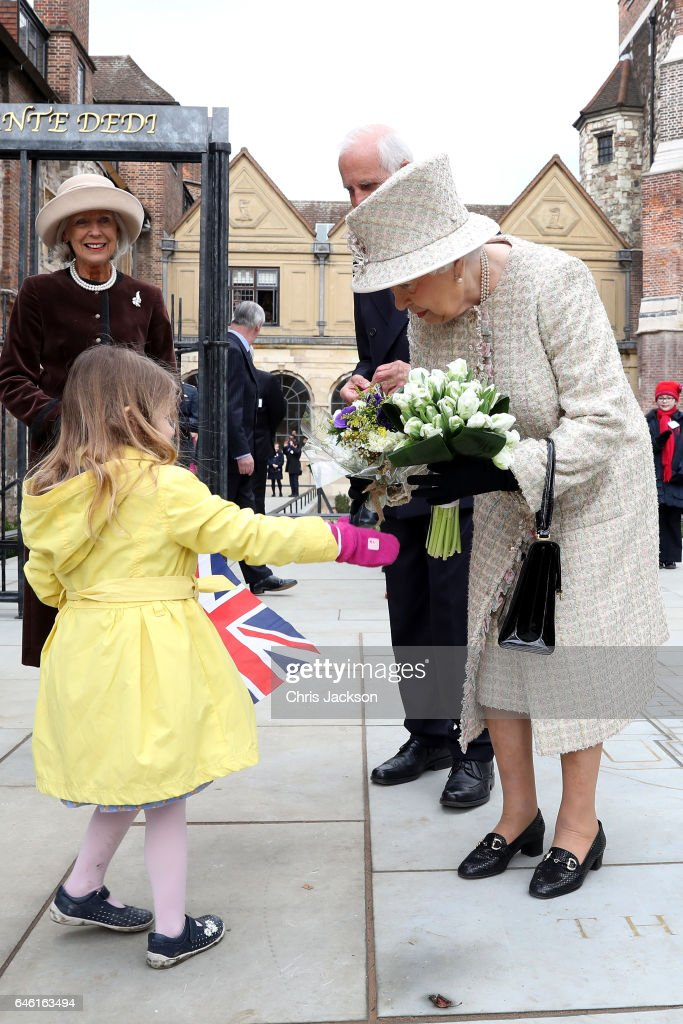 Queen Elizabeth II receives flowers from a child as she and Prince Philip, Duke of Edinburgh open a new development at The Charterhouse at Charterhouse Square on February 28, 2017 in London, England.