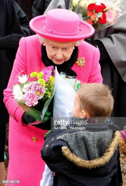 Queen Elizabeth II receives flowers from local children outside Flitcham Church Flitcham Norfolk