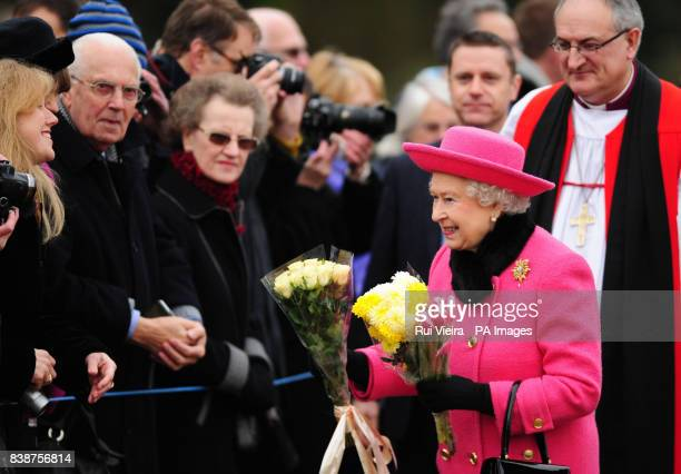 Queen Elizabeth II receives flowers from local residents outside Flitcham Church Flitcham Norfolk