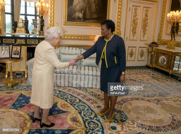 Queen Elizabeth II receives Governor-General of Barbados Dame Sandra Mason during a private audience at Buckingham Palace on March 28, 2018 in...