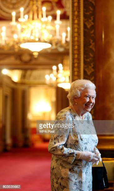 Queen Elizabeth II receives guests during the 2017 Queen's Young Leaders Awards Ceremony at Buckingham Palace on June 29 2017 in London England The...
