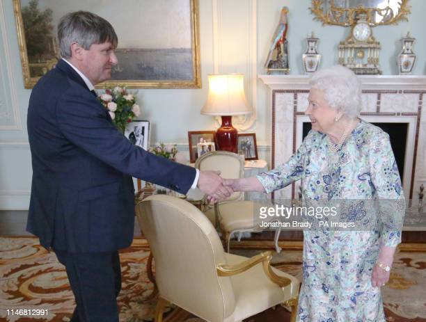 Queen Elizabeth II receives Simon Armitage to present him with The Queen's Gold Medal for Poetry upon his appointment as Poet Laureate during an...