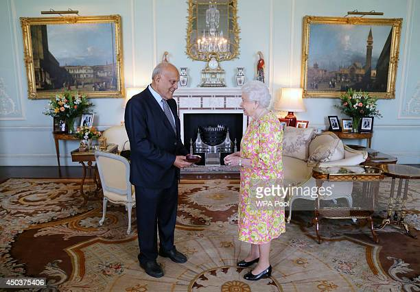 Queen Elizabeth II receives Sir Magdi Yacoub during an audience at Buckingham Palace where he presented the Insignia of a member of the Order of...