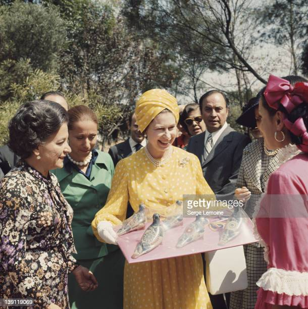 Queen Elizabeth II receives some local crafts during her state visit to Mexico 1975