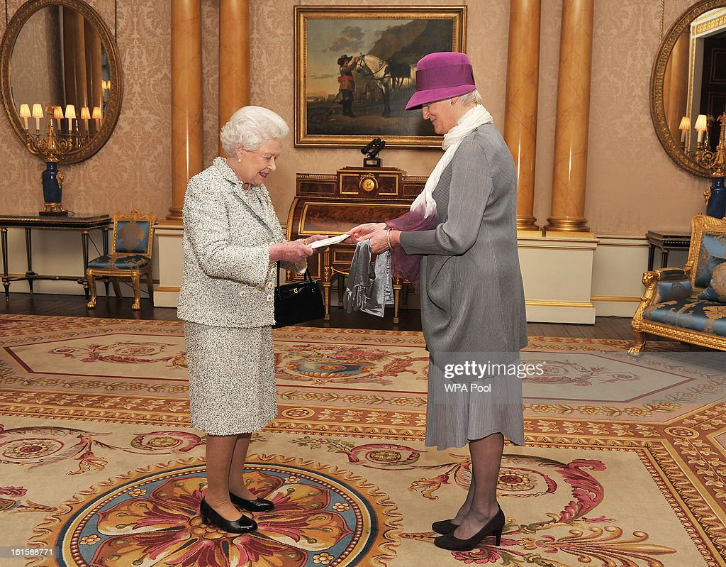Queen Elizabeth II receives the Credentials from the Ambassador of the Netherlands Ms Laetitia van den Assum, during a private audience at Buckingham Palace on February 12, 2013 in London, England.