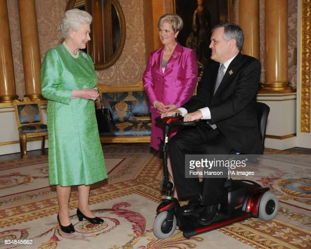 Queen Elizabeth II receives The Lieutenant Governor of Ontario The Honourable David Onley and Mrs Onley at Buckingham Palace in London