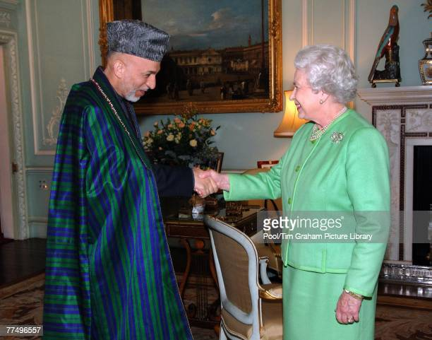 Queen Elizabeth II receives the President of Afghanistan Hamid Karzai in the Private Audience Room at Buckingham Palace on October 24 2007 in London...
