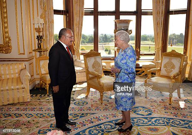 Queen Elizabeth II receives the Prime Minister of Papua New Guinea Peter O'Neill during a private audience in the White room of Windsor Castle on...