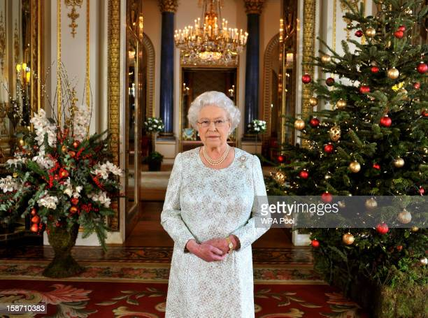 Queen Elizabeth II records her Christmas message to the Commonwealth, in 3D for the first time, in the White Drawing Room at Buckingham Palace on...