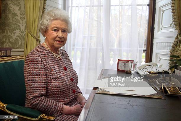 Queen Elizabeth II records the Commonwealth Day Message in the Regency Room at Buckingham Palace on February 11 2010 in London England During her...