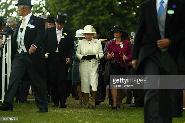 Queen Elizabeth II returns from the Padock before the running of the 3RD Race run at Ascot Racecourse on June 19 2004 at Ascot England Today was the...