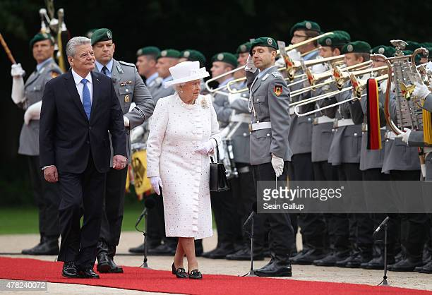 Queen Elizabeth II reviews a guard of honour with German President Joachim Gauck on her arrival at Schloss Bellevue palace on the second day of the...