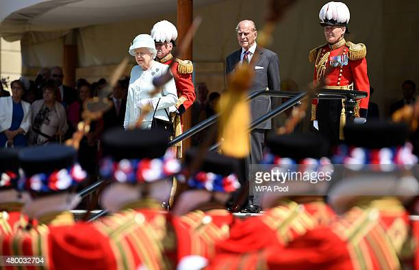 Queen Elizabeth II reviews members of The Queen's Body Guard of the Yeomen of the Guard in the garden at Buckingham Palace on July 9 2015 in London...