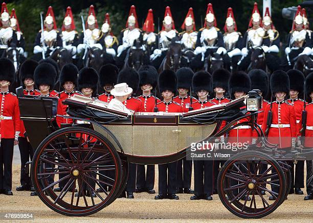 Queen Elizabeth II reviews the Royal Guards during the annual Trooping The Colour ceremony at Horse Guards Parade on June 13 2015 in London England