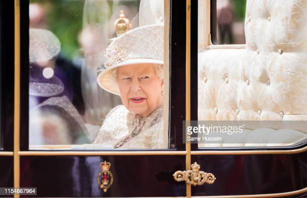 Queen Elizabeth II rides by carriage down the Mall during Trooping The Colour the Queen's annual birthday parade on June 08 2019 in London England