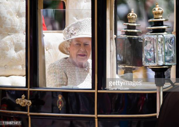 Queen Elizabeth II rides by carriage down the Mall during Trooping The Colour, the Queen's annual birthday parade, on June 08, 2019 in London,...