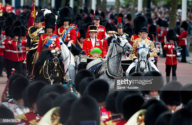 Queen Elizabeth II rides by carriage during the Trooping the Colour this year marking the Queen's official 90th birthday at The Mall on June 11 2016...