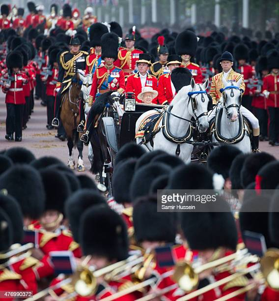 Queen Elizabeth II rides in a carriage as she attends the annual Trooping The Colour ceremony at Horse Guards Parade on June 13 2015 in London England