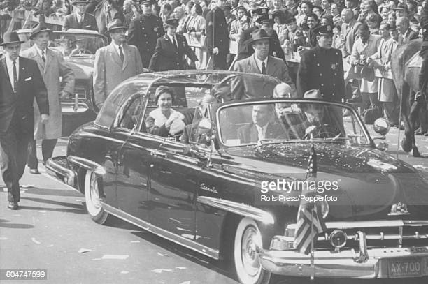 Queen Elizabeth II rides in a Lincoln bubble top limousine as part of a royal motorcade with New York Governor Averell Harriman and official greeter...