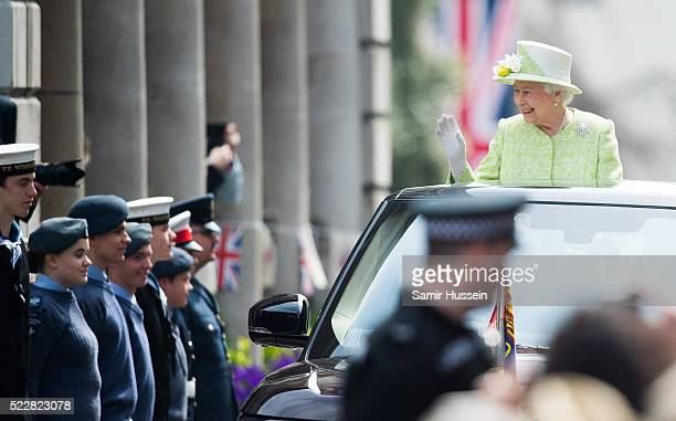 Queen Elizabeth II rides in an open top vehicle around Windsor on her 90th Birthday on April 21 2016 in Windsor England