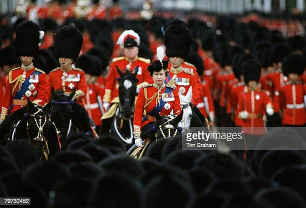 Queen Elizabeth II rides sidesaddle during Trooping the Colour ceremony Riding behind are Prince Philip Duke of Edinburgh and Prince Charles Prince...
