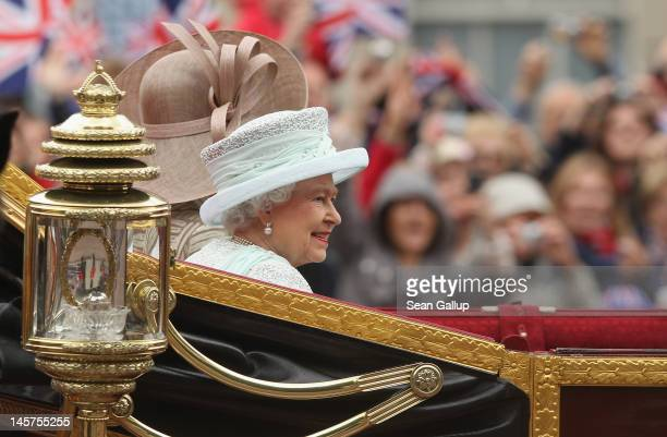 Queen Elizabeth II rides towards Buckingham Palace in a royal procession during the Diamond Jubilee on June 5 2012 in London England For only the...