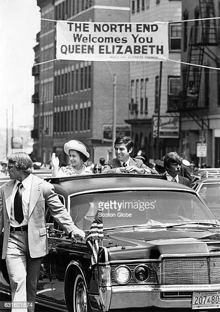Queen Elizabeth II rides with Gov Michael Dukakis through the North End during her visit to Boston July 11 1976