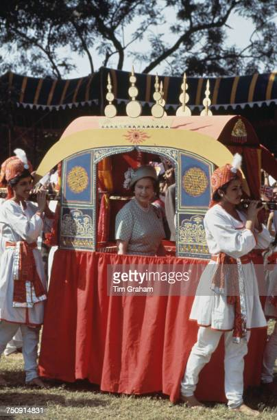 Queen Elizabeth II riding in a traditional Indian 'Palki' during a visit to Delhi India 17th November 1983