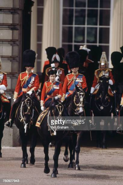 Queen Elizabeth II riding sidesaddle during the Trooping the Colour procession London 13th June 1981 Behind her are Prince Charles and Prince Philip