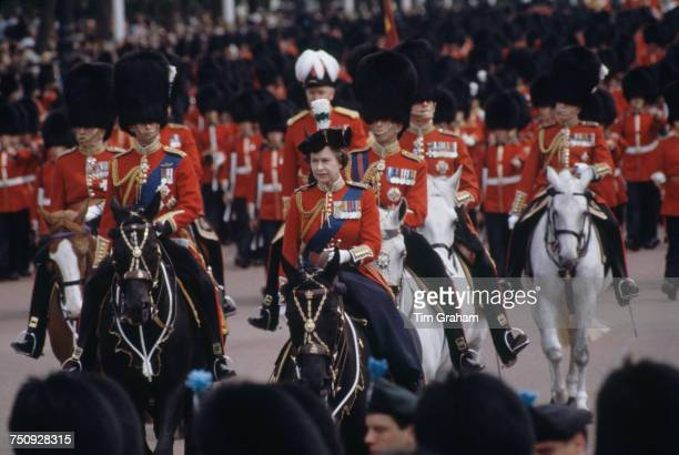 Queen Elizabeth II riding sidesaddle during the Trooping the Colour procession, London, 13th June 1981. Behind her are Prince Charles and Prince...