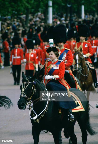 Queen Elizabeth II riding sidesaddle takes part in the Trooping the Colour procession