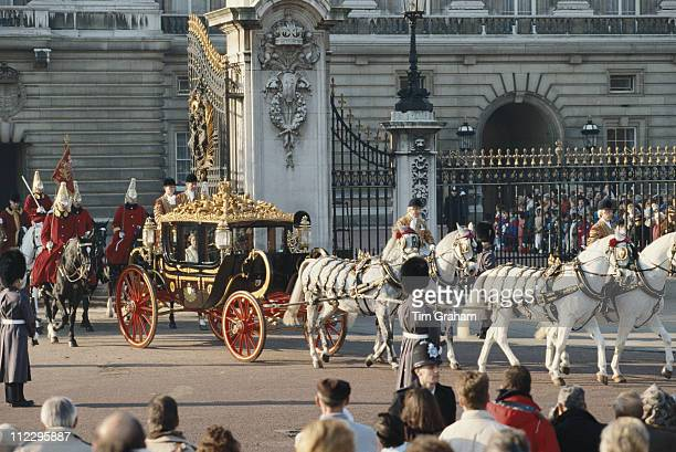 Queen Elizabeth II riding the State Coach as it leaves Buckingham Palace for the House of Lords and the State Opening of Parliament in London England...
