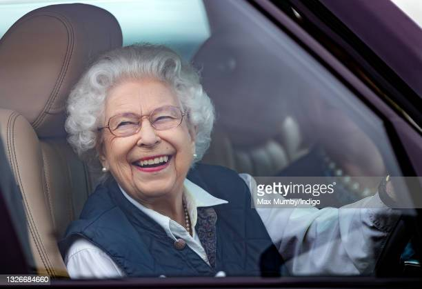 Queen Elizabeth II seen driving her Range Rover car as she attends day 2 of the Royal Windsor Horse Show in Home Park, Windsor Castle on July 2, 2021...