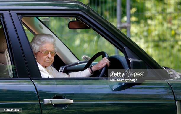Queen Elizabeth II seen driving her Range Rover car as she watches the International Carriage Driving Grand Prix event on day 4 of the Royal Windsor...