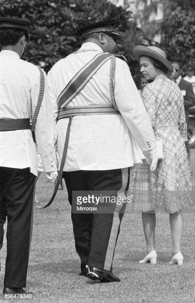 Queen Elizabeth II seen here in Tonga with the King Taufa'ahau Tupou IV of Tonga during her on her Silver Jubilee tour of Australia and the Far East,...