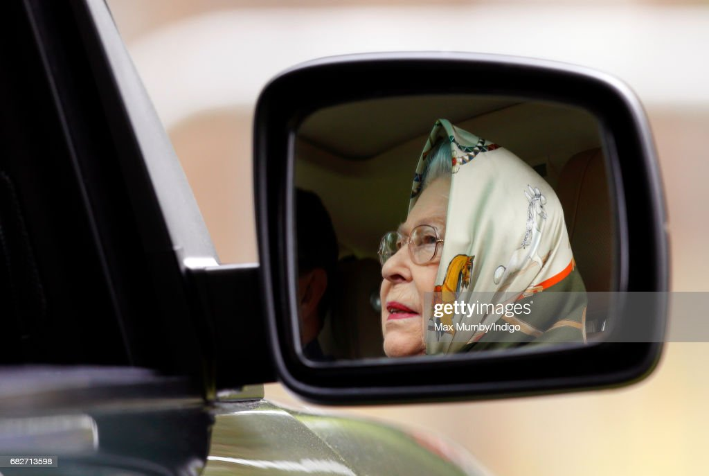 Queen Elizabeth II seen reflected in the wing mirror of her Range Rover car as she drives around on day 4 of the Royal Windsor Horse Show in Home Park on May 13, 2017 in Windsor, England.