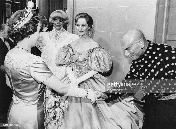 Queen Elizabeth II shakes hands with actor Yul Brynner after the Royal Variety Performance at the Theatre Royal Drury Lane London 27th December 1979...