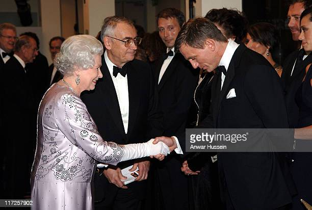 HM Queen Elizabeth II shakes hands with British actor Daniel Craig the new James Bond at the Royal Premiere for the 21st Bond film 'Casino Royale' at...