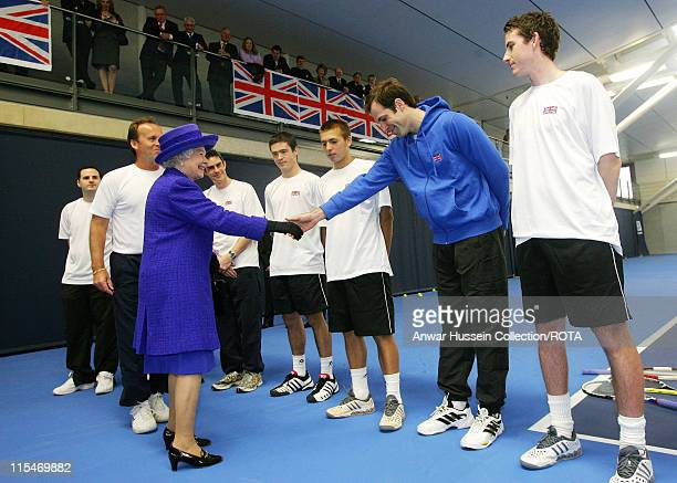 Queen Elizabeth II shakes hands with British tennis player Greg Rusedski during her visit to the new National Tennis Centre Roehampton in London on...