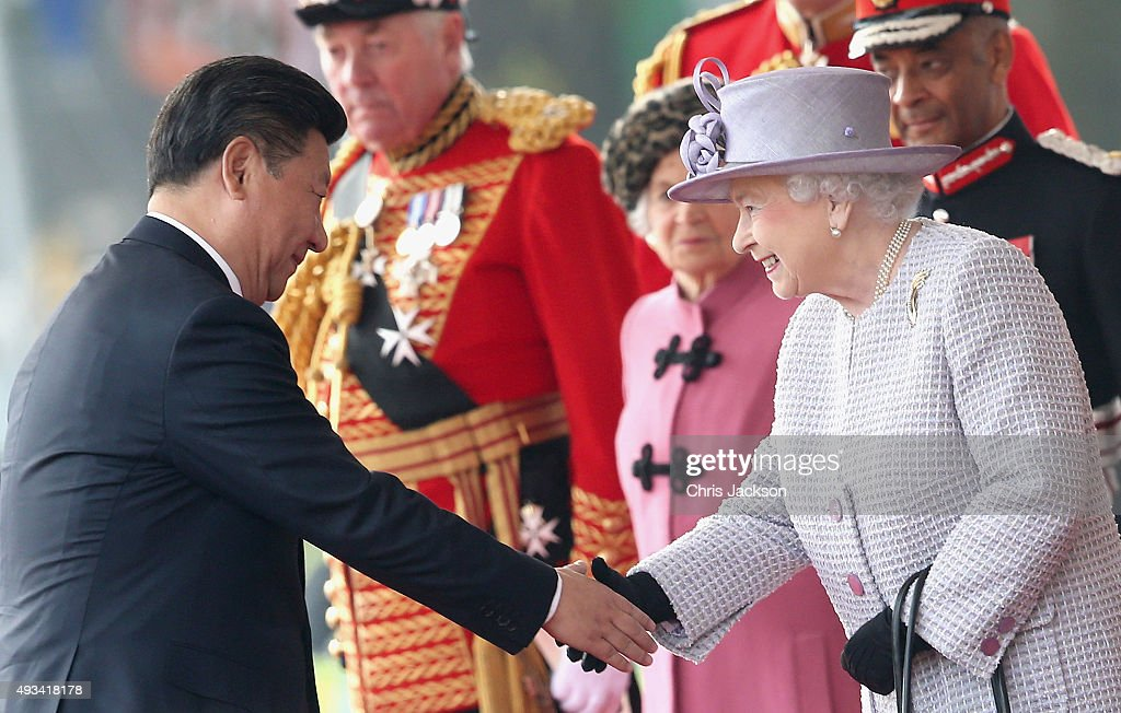Queen Elizabeth II shakes hands with Chinese President Xi Jinping on Horseguards Parade during the Official Ceremonial Welcome for the Chinese State Visit on October 20, 2015 in London, England. The President of the Peoples Republic of China, Mr Xi Jinping and his wife, Madame Peng Liyuan, are paying a State Visit to the United Kingdom as guests of The Queen. They will stay at Buckingham Palace and undertake engagements in London and Manchester. The last state visit paid by a Chinese President to the UK was Hu Jintao in 2005.