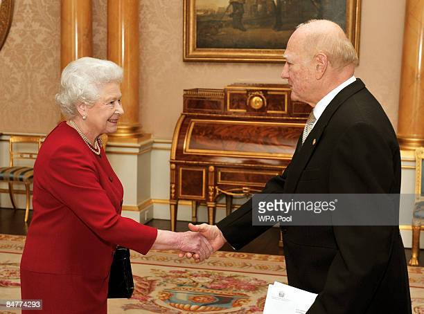 Queen Elizabeth II shakes hands with El Salvador's ambassador to London Dr Roberto AvilaAvilez at Buckingham Palace on February 13 2009 in London...