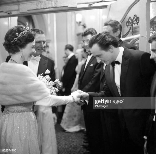 HRH Queen Elizabeth II shakes hands with entertainer Ken Dodd Also picture is Frank Ifield Max Bygraves Spike Milligan and Dudley Moore