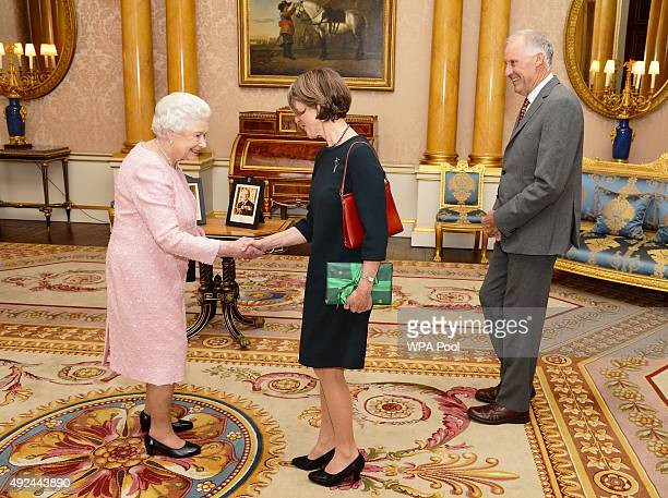 Queen Elizabeth II shakes hands with Her Excellency Professor Kate Warner the Governor of Tasmania who was accompanied by Mr Richard Warner during a...