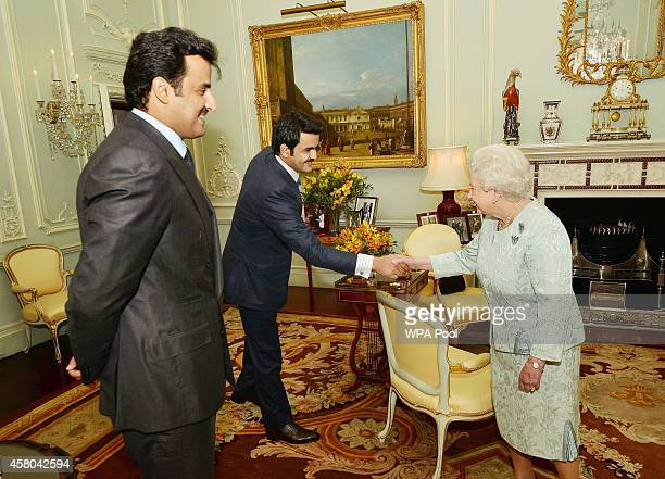 Queen Elizabeth II shakes hands with His Excellency Sheikh Joaan bin Hamad AlThani the younger brother of the Emir of Qatar Sheikh Tamim bin Hamad Al...