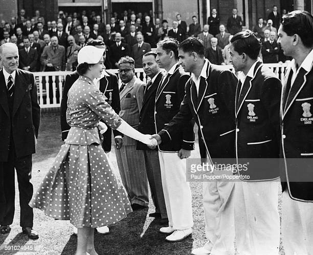 Queen Elizabeth II shakes hands with Indian cricketer Vinoo Mankad as she meets the Indian Cricket Team prior to the 4th day of play of the 2nd Test...