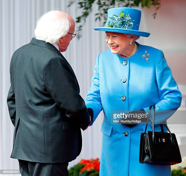 Queen Elizabeth II shakes hands with Irish President Michael D Higgins during his ceremonial welcome on April 8 2014 in Windsor England This is the...