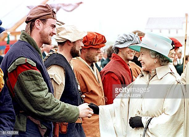 Queen Elizabeth II shakes hands with Nigel Church a crew member of the Matthew in Bonavista Newfoundland 24 June The Matthew is a replica of the ship...
