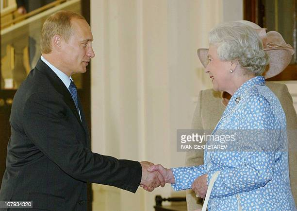 Queen Elizabeth II shakes hands with Russian President Vladimir Putin bidding farewell to him and his wife Lyudmila in Buckingham Palace in London 27...