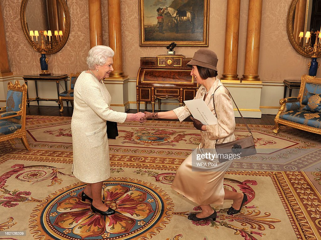 Queen Elizabeth II shakes hands with San Marino Ms Federica Bigi, during a private audience presenting his Credentials at Buckingham Palace on February 19, 2013 in London, England.