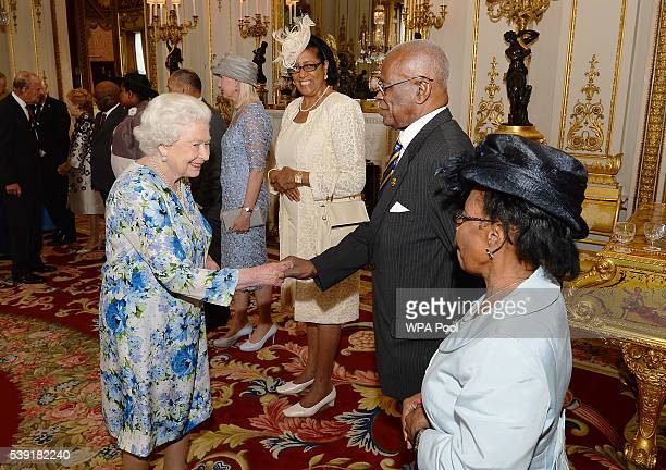 Queen Elizabeth II shakes hands with Sir Elliott Belgrave of Barbados during a reception ahead of a lunch at Buckingham Palace on June 10, 2016 in...